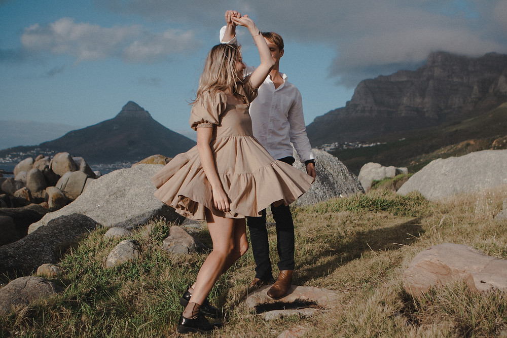 Engagement photoshoot of a couple dancing