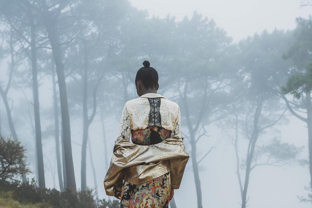 Black Model in mist wearing vintage style clothing