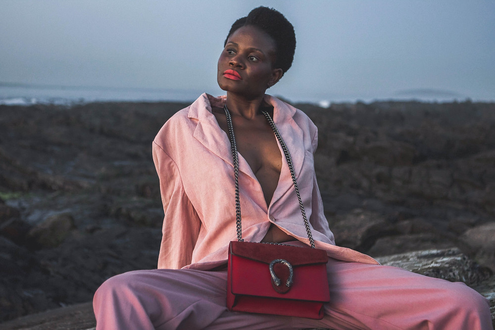 African Model wearing pink wool blazer and Gucci bag