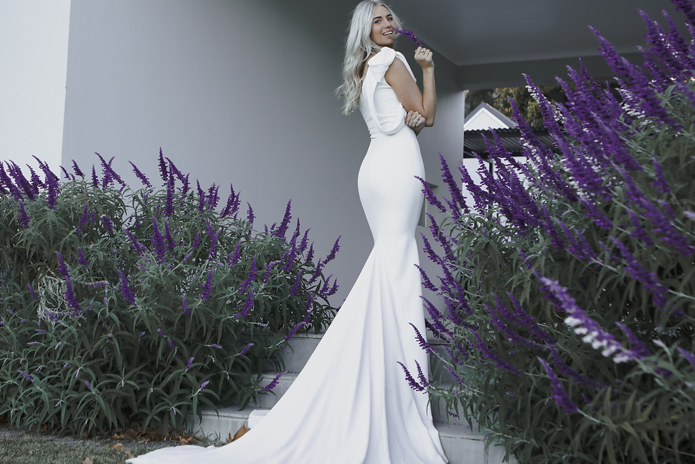 Bride photographed infront of lavender flowers