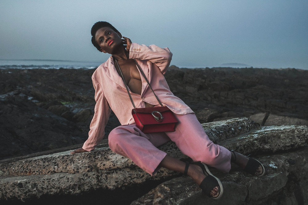 African model wearing pink wool blazer and pink pants
