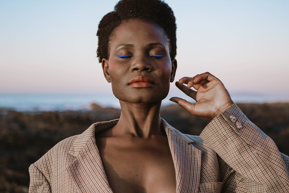 African model with blue eyeliner on