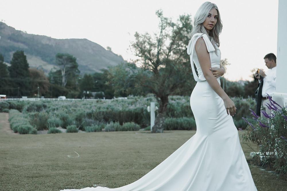 Bride in minimalistic white dress in lavender farm