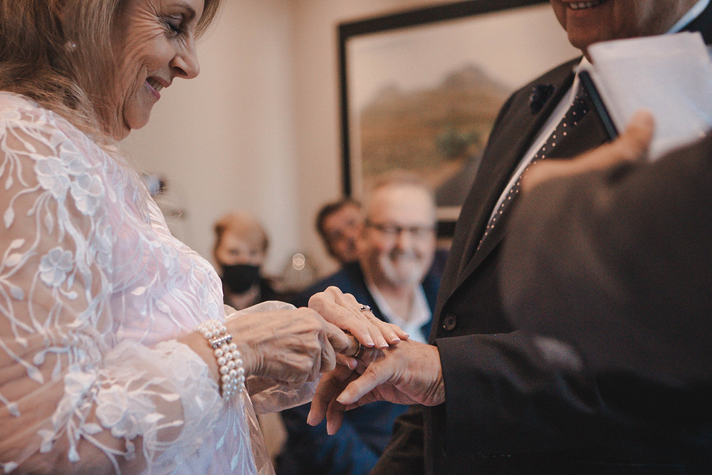 Bride handing over the ring