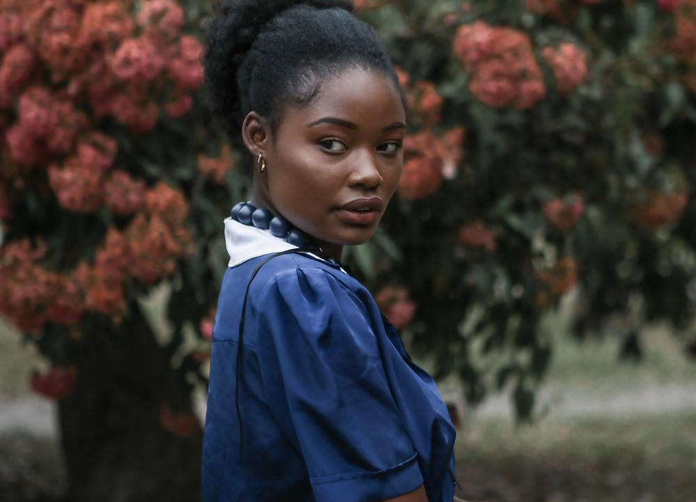 Model looking over her shoulder in garden setting
