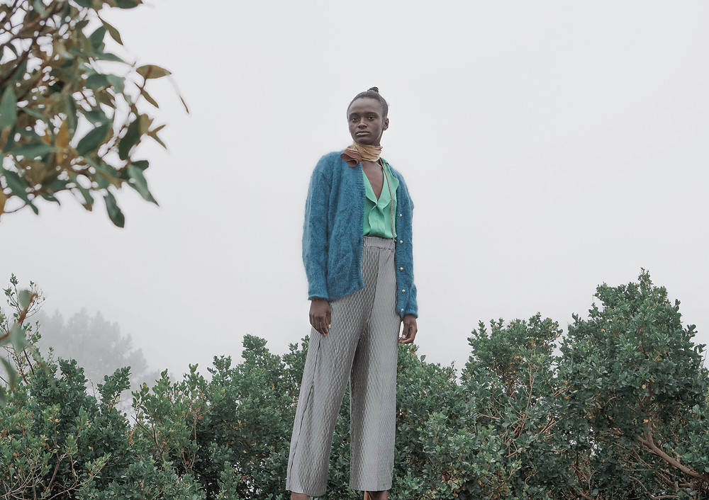 Black Model in mist wearing retro clothing