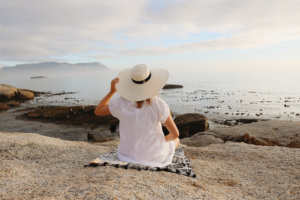 Person in summer dress watching the ocean view