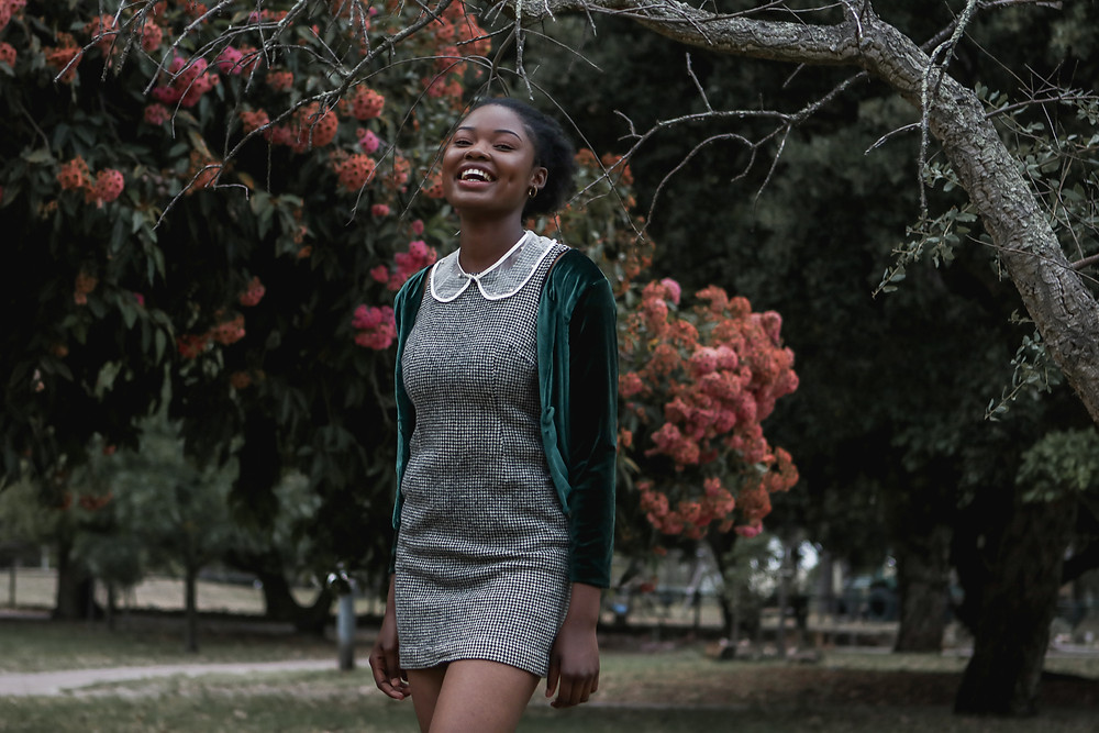 African model laughing in park
