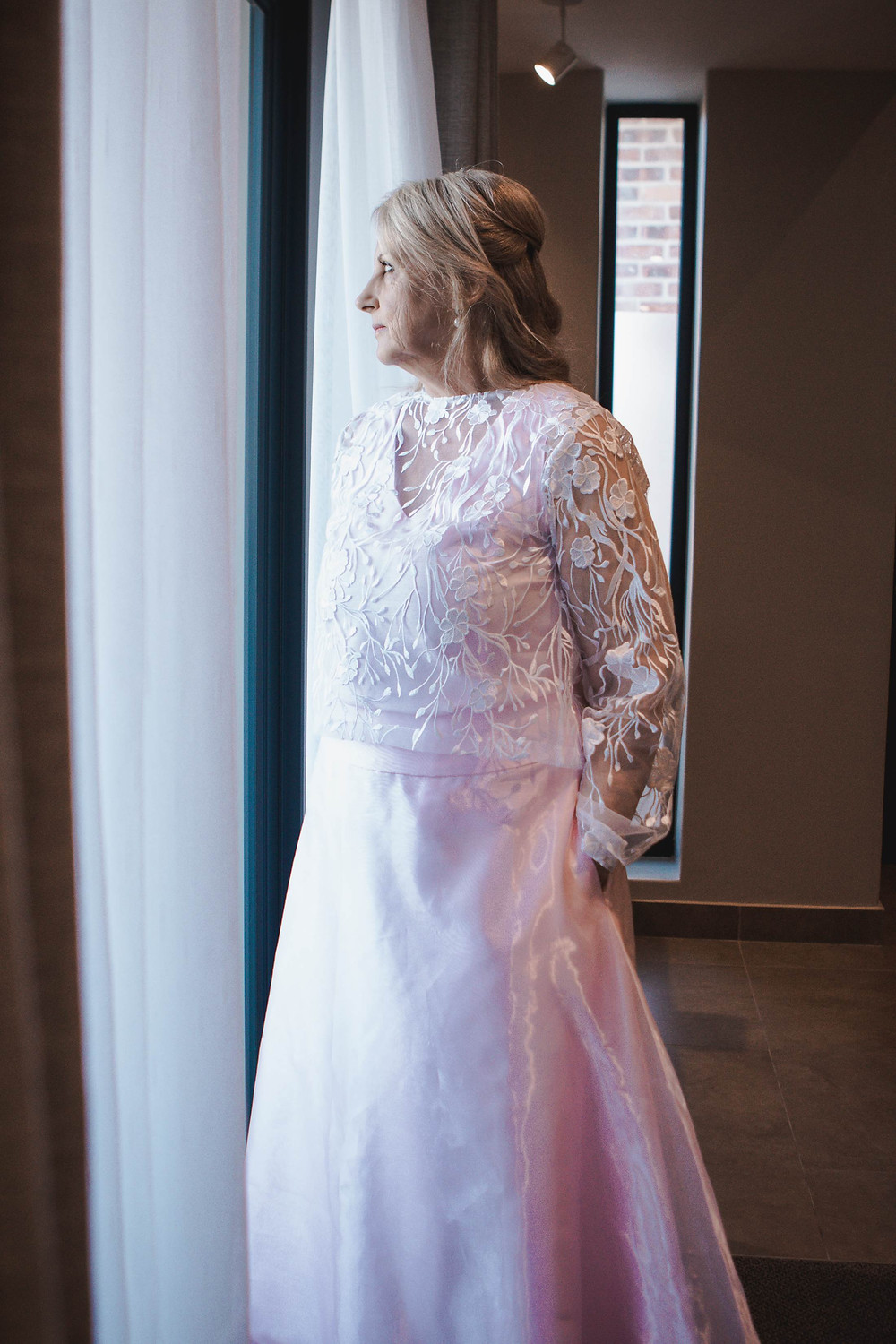 wedding photos bride staring out of window