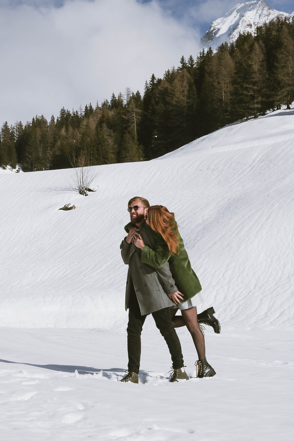 Cute couple in the snow in Switzerland