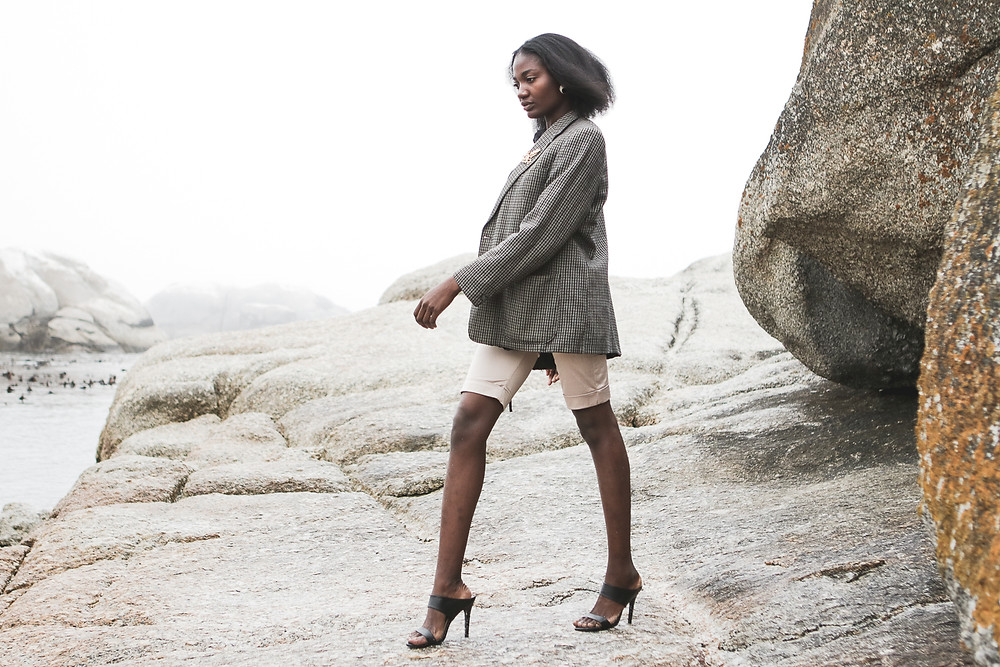 African model wearring a hounstooth blazer high fashion editorial look