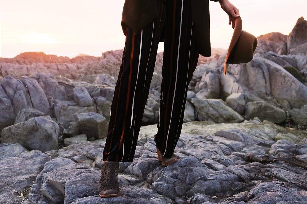 Walking over rocks in heels