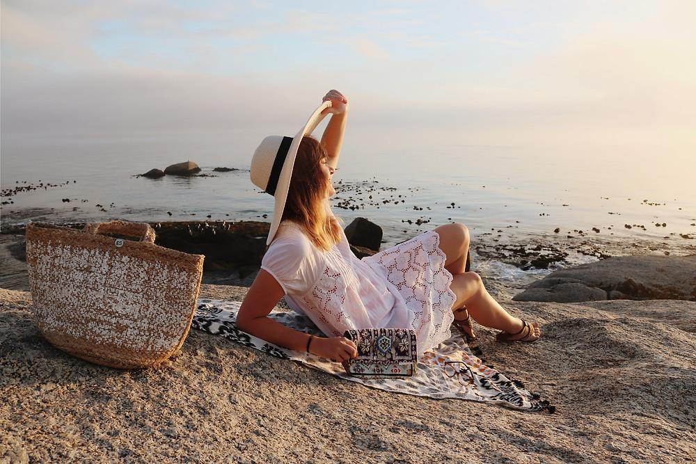 Summer dress and woven bag beach view