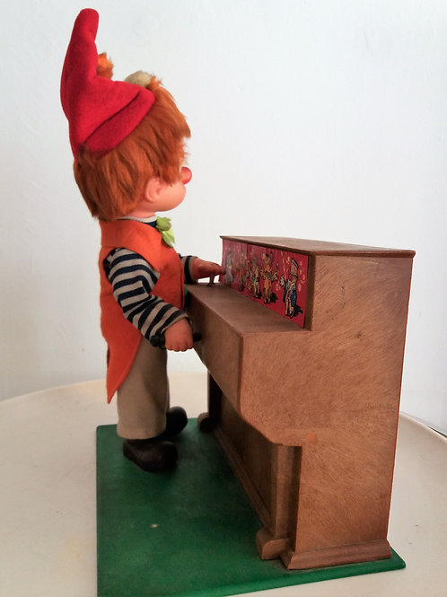 Payaso pianista de juguete autómata