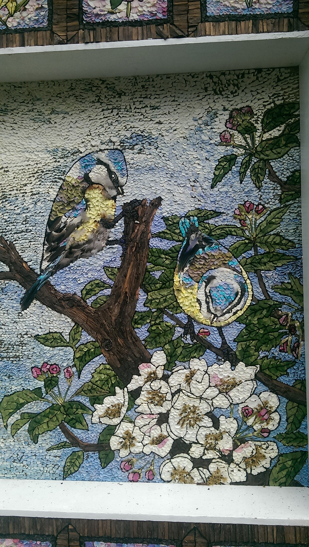 Detail of flowers and birds in Well Dressing at Stoney Middleton