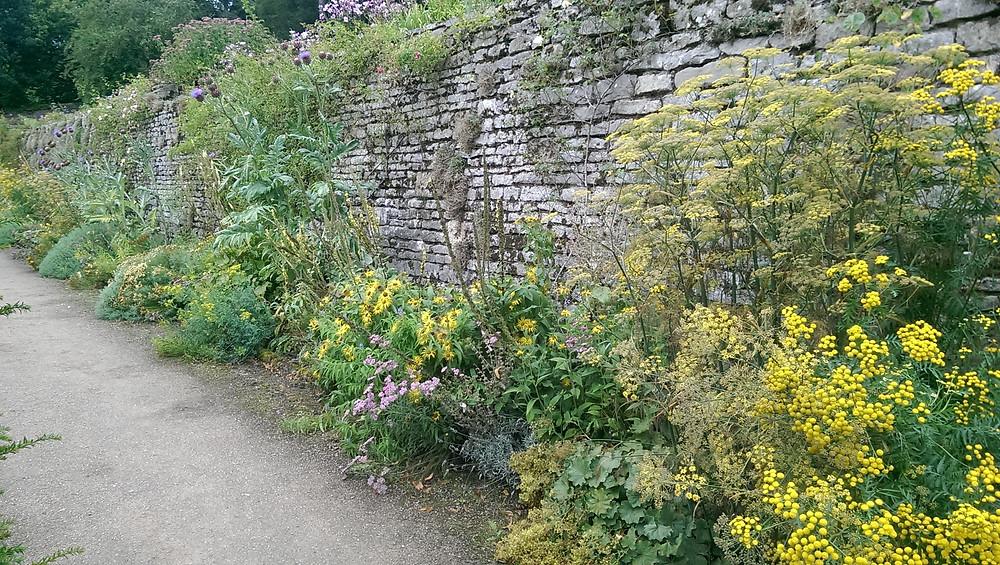 stone walls, gentle walks and yellow flower borders