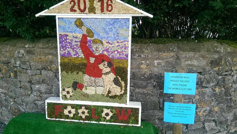 Pickles the dog at World Cup football Well Dressing in Foolow The Peak District