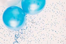Studio shot of balloons on colored spott