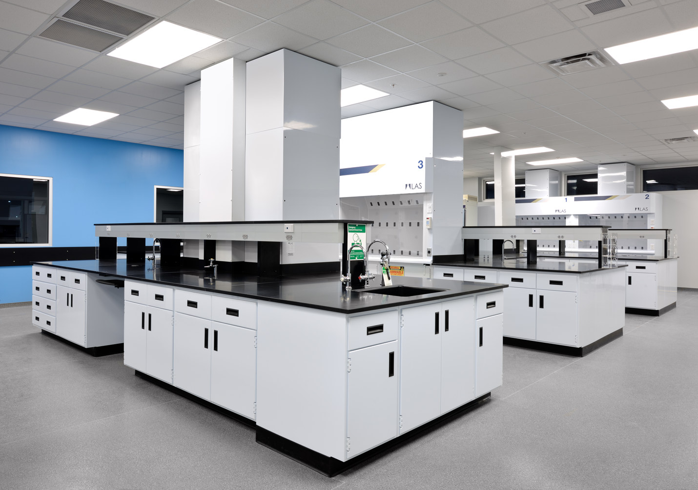 Open concept laboratory with centrally-located fume hood