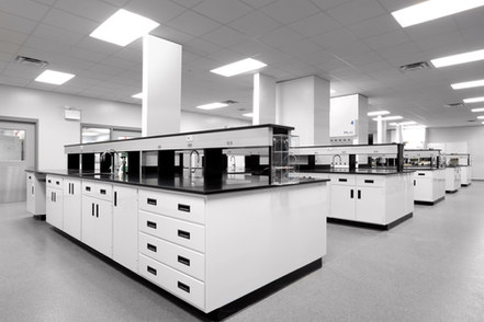 Chemically-resistant work stations with sinks and under counter storage