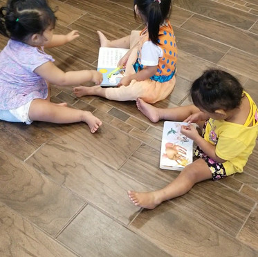 Kids playing with books on floor.mp4