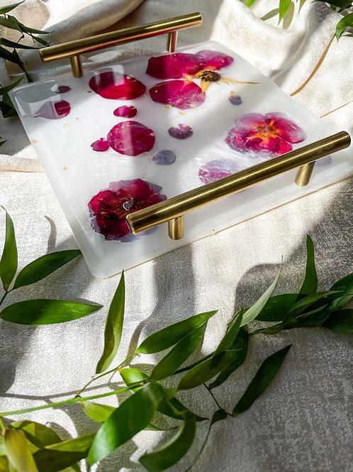 Pressed red rose petals in milk bath acrylic tray