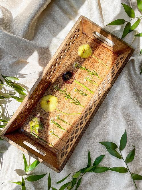 Wild flowers in wooden tray