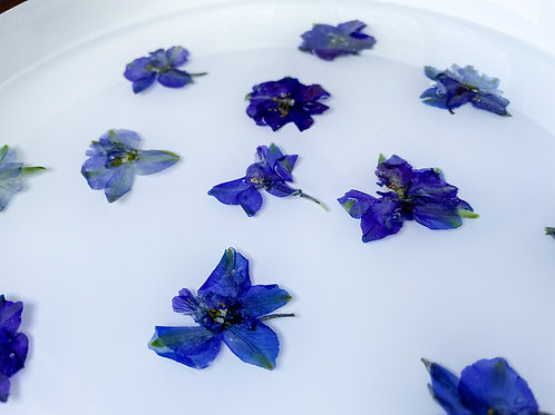 """Copy""""Floating"""" blue delphinium in round wooden tray"""