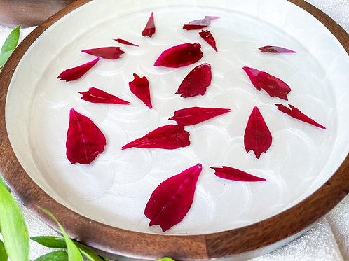 """""""Floating"""" Flower red peony petals in round wooden tray"""