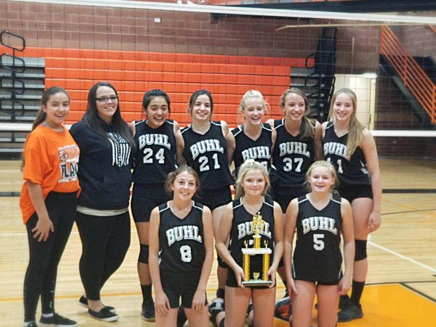 The BMS Volleyball Team won the Buhl School Invitational. They get together for a team picture with the trophy.