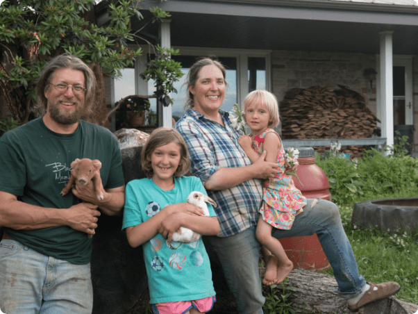 Greg, Jen, and their two kids at Blackberry Meadows Farm