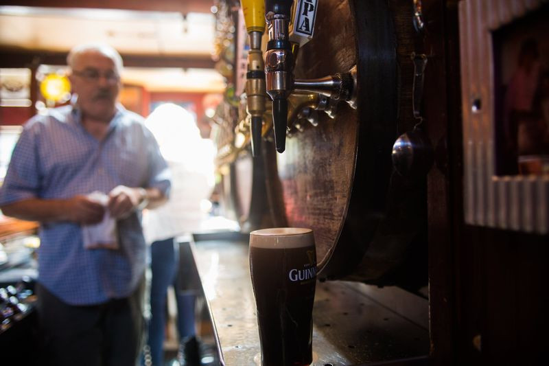 Behind the bar at Valley Tavern, a perfectly-poured pint of Guinness