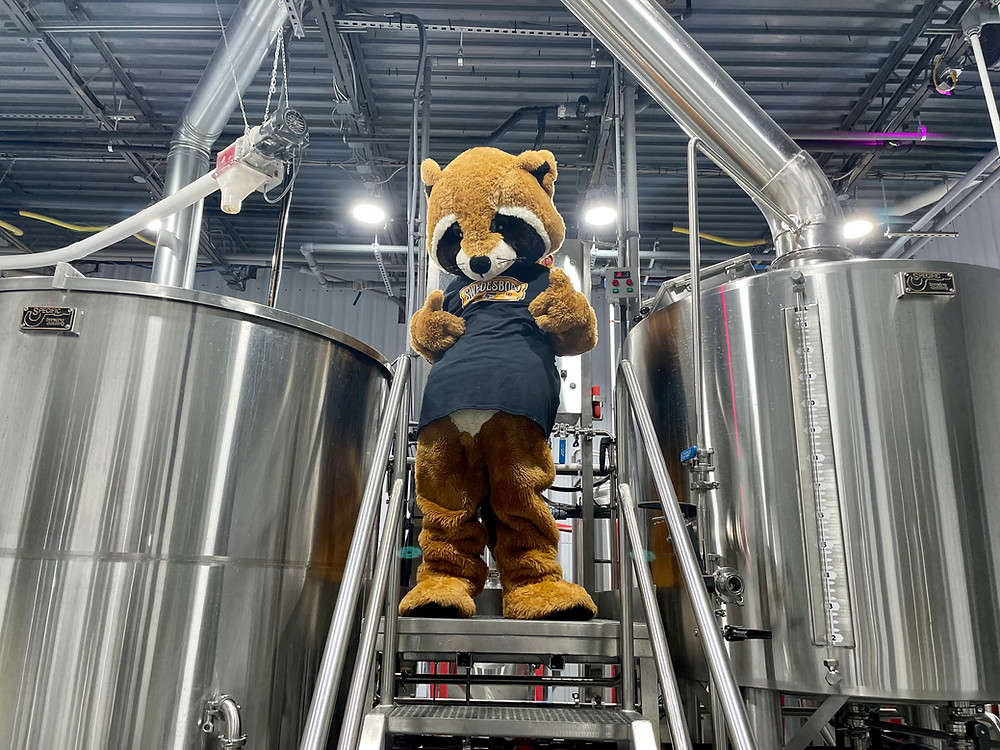 Swedesboro Brewing Company's mascot, Hoppie, in the brewhouse