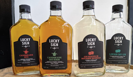 a selection of spirits from Lucky Sign: rye whiskey, bourbon, gin