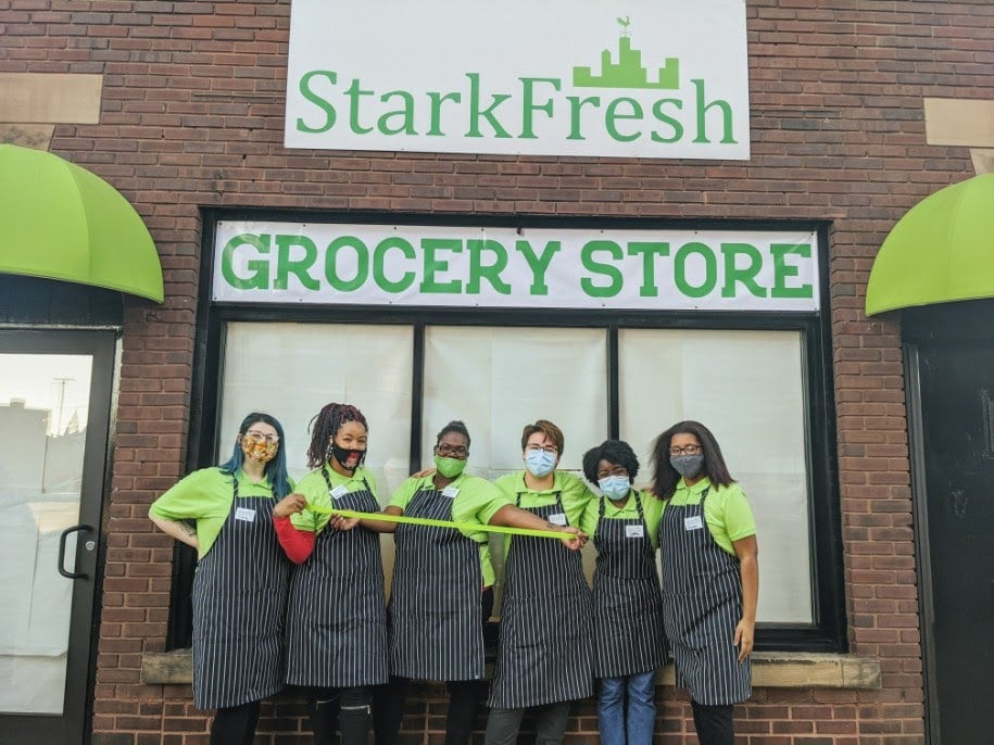 six employees stand outside of StarkFresh Grocery Store