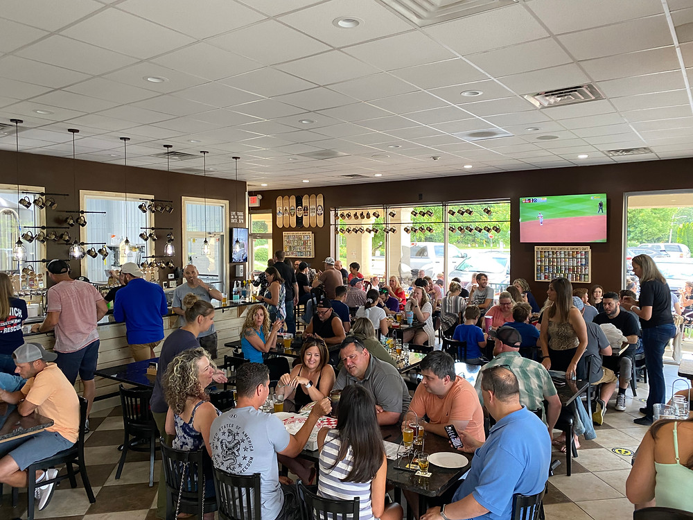 a crowd of customers filling up Swedesboro Brewing Company