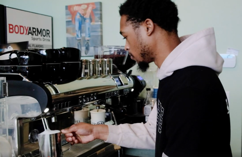 Barista steams milk at UnBar Cafe in Cleveland