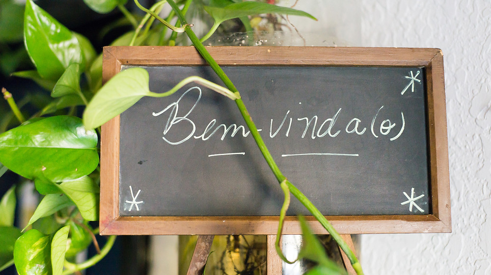 """a chalkboard sign at Casa Brasil in Pittsburgh that reads """"bem-vinda"""" (welcome in Portuguese)"""