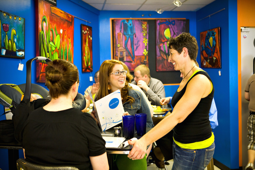 Owner Sherree Goldstein chats with customers at Square Cafe in Pittsburgh