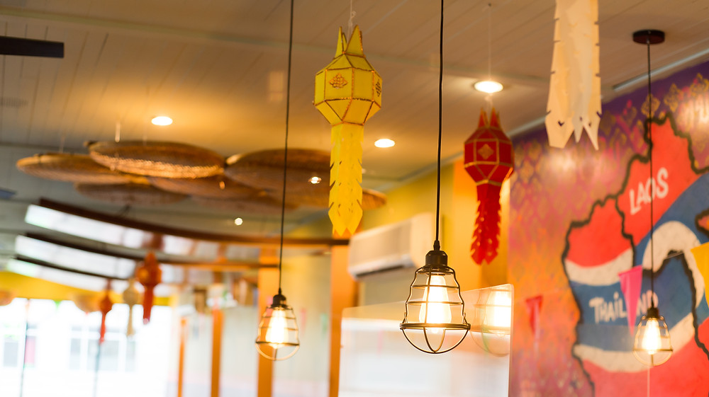 Traditional lanterns and baskets hang from the ceiling at Kiin Lao and Thai Eatery