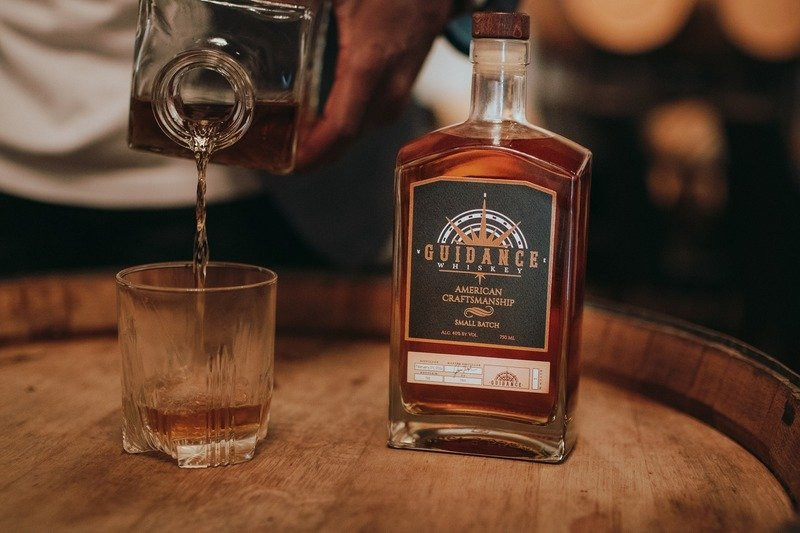 Guidance Whiskey, a Black-owned small-batch whiskey is poured into a glass