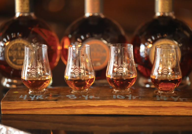 four snifters of Western Reserve Distillery organic whiskey