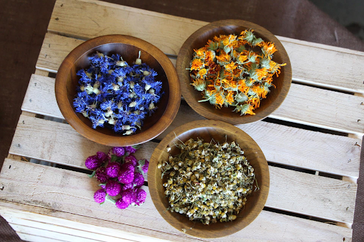 bowls of dried herbs and flowers for Cherry Valley Organics teas