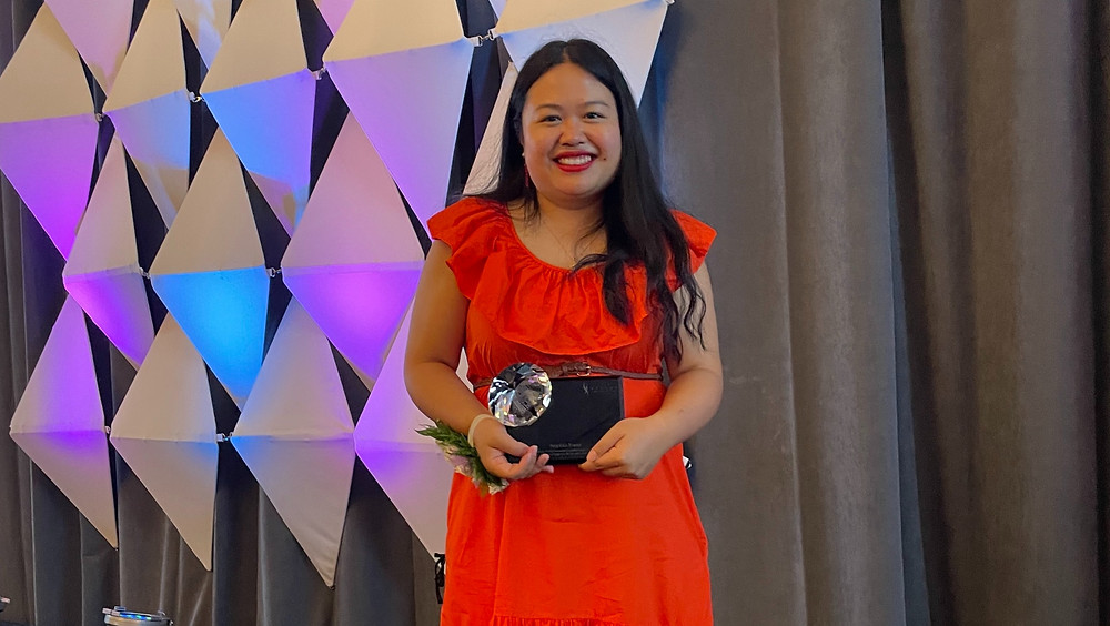 Sophia Fang, head of marketing at Honeycomb Credit, holds her Young Athena Award