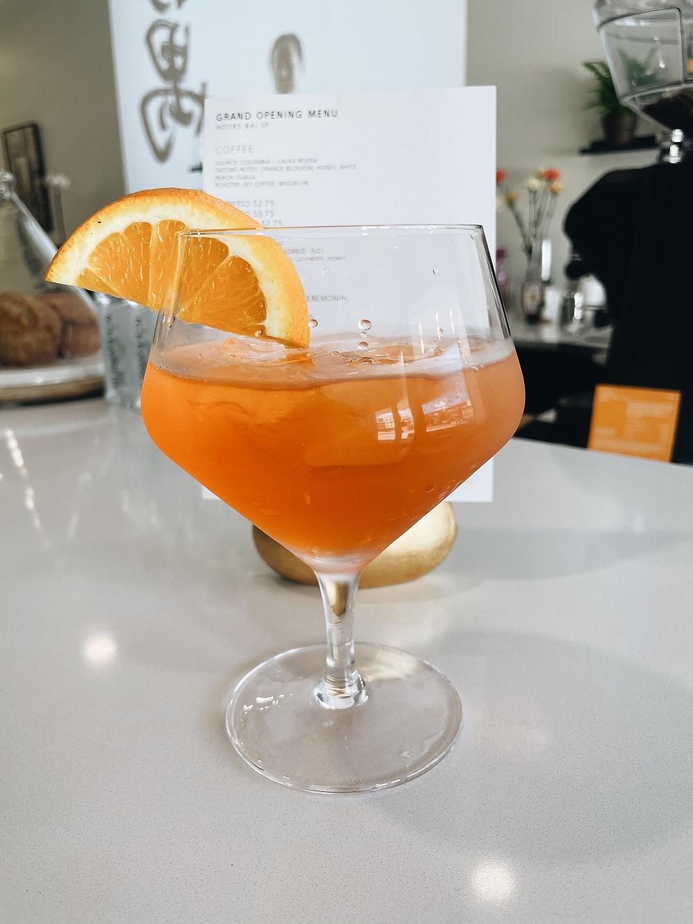 an orange mocktail at Tonic Coffee