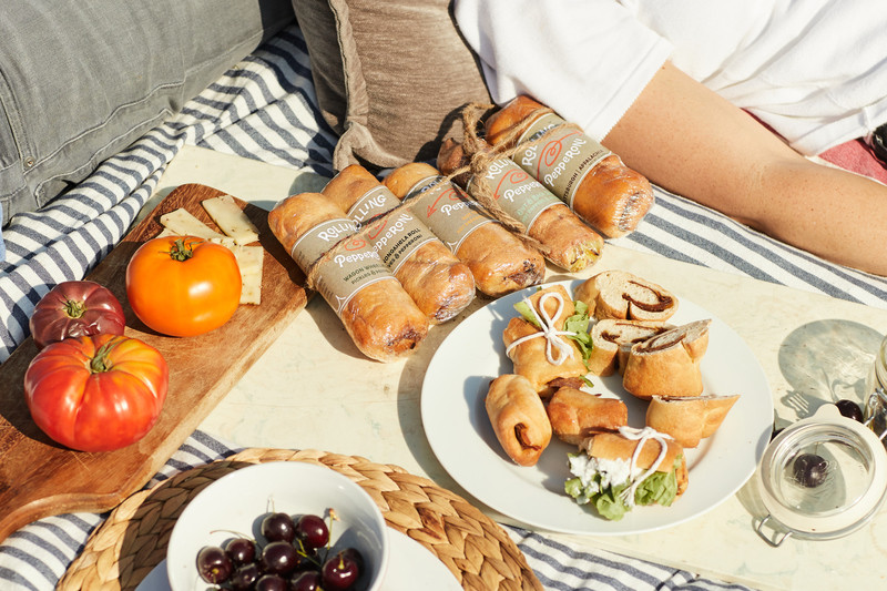 a picnic of Rolling Pepperoni products, a small business that crowdfunded on Honeycomb Credit