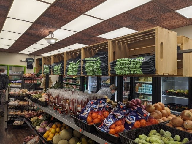 Shelves of fresh fruit and vegetables at StarkFresh Grocery Store