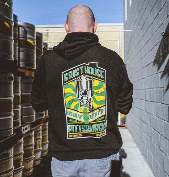 a man with back to camera wears a Grist House Brewery hoodie