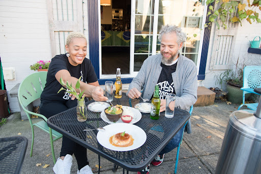 Casa Brasil owners Keyla and Tim enjoy a meal on the restaurant's patio