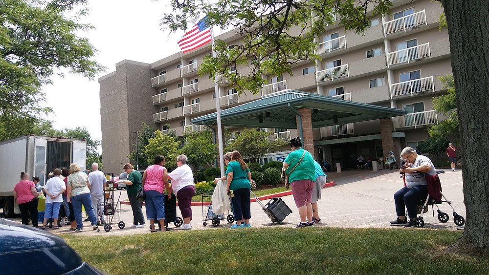 Customers lining up for one of StarkFresh's mobile farmer's markets outside of a nursing home in Canton